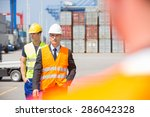 male workers walking in... | Shutterstock . vector #286042328