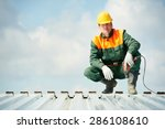worker builder with hand drill... | Shutterstock . vector #286108610
