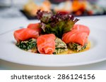 pink salmon rolls on a white... | Shutterstock . vector #286124156