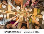 Group Of People Toasting And...