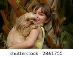 a young girl holding her cute...   Shutterstock . vector #2861755