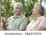 old couple sharing a laugh | Shutterstock . vector #286313534