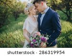 couple in wedding attire with a ... | Shutterstock . vector #286319954