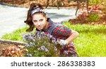 pretty young woman in garden   Shutterstock . vector #286338383