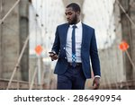 young businessman using mobile... | Shutterstock . vector #286490954