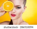 young woman with oranges on a... | Shutterstock . vector #286510094