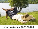 a man taking a nap after meal... | Shutterstock . vector #286560989
