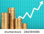 pile of coins and upside... | Shutterstock . vector #286584080