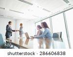 businesspeople shaking hands in ... | Shutterstock . vector #286606838