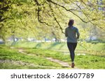 Young Woman Jogging In City...