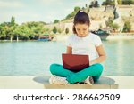 happy young girl using laptop... | Shutterstock . vector #286662509