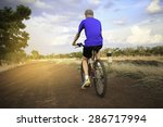 cyclist on the road with grass. | Shutterstock . vector #286717994