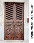 old iron door with wrought iron ...   Shutterstock . vector #286788389