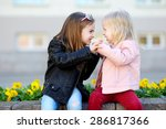 two little sisters fighting... | Shutterstock . vector #286817366
