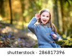 adorable little girl picking... | Shutterstock . vector #286817396