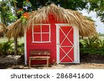 Small Red House With Palm...