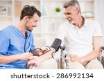 male doctor measuring blood... | Shutterstock . vector #286992134