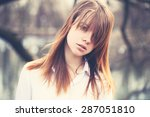 Small photo of Vintage Style Portrait of Young Beautiful Girl with Windy Hair