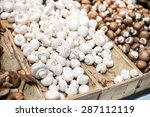 Pile Of White Mushrooms In A...