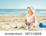 Baby Playing On The Sandy Beac...