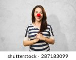 Smiling Woman With A Clown Nos...
