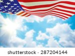 American Flag On Sky Backgroun...