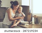 mom with her 2 years old child... | Shutterstock . vector #287219234
