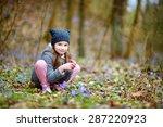 adorable little girl picking... | Shutterstock . vector #287220923