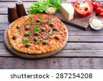 pizza on wooden background | Shutterstock . vector #287254208