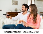 happy smiling couple watching... | Shutterstock . vector #287257340