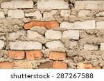 Small photo of Bodged brick wall with messy loose cement