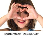 Girl Making A Heart With Her...