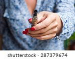 closeup hand of woman with e... | Shutterstock . vector #287379674