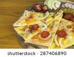 homemade pizza  sliced on a... | Shutterstock . vector #287406890