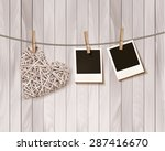 wooden heart with photographs.... | Shutterstock .eps vector #287416670