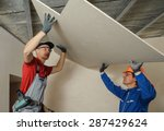 Drywall Installers. Men Holdin...