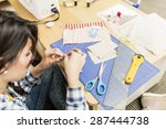 young girl making hand bags and ... | Shutterstock . vector #287444738