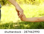 a the parent holding the hand... | Shutterstock . vector #287462990