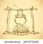 hanging on log cast iron pan on ... | Shutterstock .eps vector #287475650