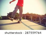 skateboarder legs riding... | Shutterstock . vector #287559764