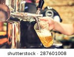 barman hand at beer tap pouring ... | Shutterstock . vector #287601008