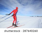 A Man Cross Country Skiing On...