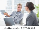 businessman showing tablet at... | Shutterstock . vector #287647544