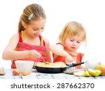 cute sisters cooking pancakes...   Shutterstock . vector #287662370