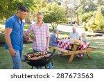 happy family having picnic in... | Shutterstock . vector #287673563