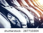 Cars In Stock Closeup. Row Of...