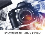 Digital Camera and Prints on Table. Photographer Desk Concept. - stock photo