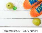 sport shoes  apple and bottle... | Shutterstock . vector #287770484