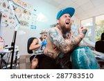 tattooist makes a tattoo | Shutterstock . vector #287783510