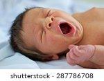 Baby Boy Yawning On A White...
